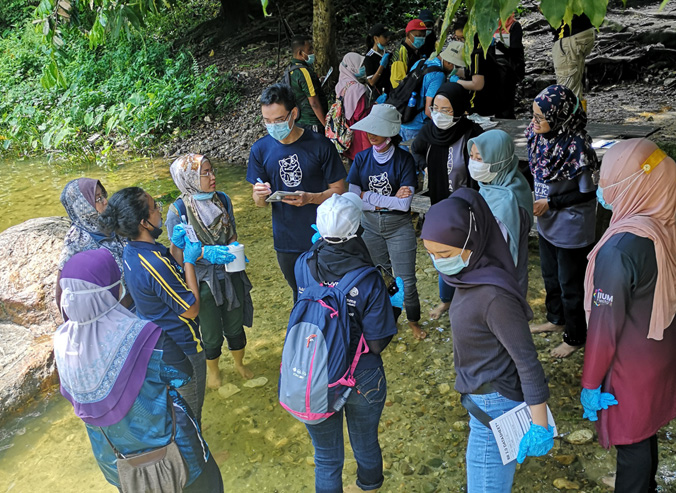 River Ranger Training session - river water quality testing in the upstream pristine Klang River near the Klang Gates Dam